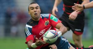Munster's Simon Zebo is tackled by Edinburgh's Cornell du Preez  at Murrayfield. Photograph:  Jeff Holmes/PA Wire