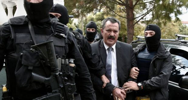 Extreme-right Golden Dawn party senior lawmaker Christos Pappas is escorted by anti-terrorism police officers to a courthouse in Athens Oearlier this month. Yorgos Karahalis/Reuters