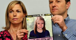 File image from last year of Madeleine McCann's parents Gerry and Kate McCann with a picture of what her daughter might look like years after her disappearance. Photograph: John Stillwell/PA Wire