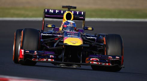 Sebastian Vettel of Germany and Infiniti Red Bull Racing on his way to winning the Japanese Formula One Grand Prix.  Photograph: Clive Mason/Getty Images