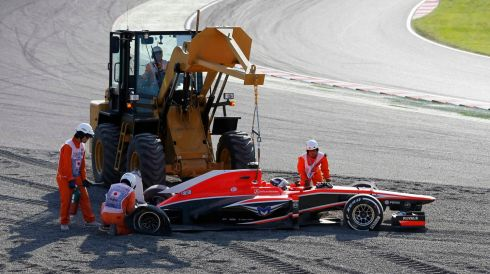 Track marshalls remove Marussia Formula One driver Jules Bianchi of France's car during the Japanese F1 Grand Prix. Photograph: Issei Kato/Reuters