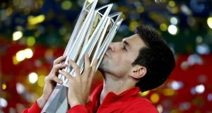 Novak Djokovic of Serbia  with the winner's trophy after defeating Juan Martin Del Potro of Argentina at the  Shanghai  Masters at the Qi Zhong Tennis Centre. Photograph:   Matthew Stockman/Getty Images