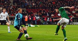 Ireland's Anthony Stokes gets his shot away but it's saved by Manuel Neuer.
