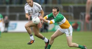 Ryan T O'Neill of Clonoe tussles for possession with  Niall Loughran of Carrickmore. Photo: Andrew Paton/Inpho