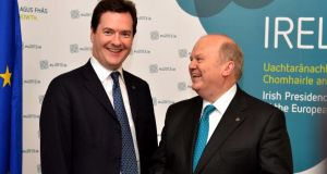 British chancellor of the exchequer George Osborne – who has been under fire from the majority of economists for artificially stoking up demand in Britain's housing market – with Minister for Finance Michael Noonan. Photograph: David Sleator