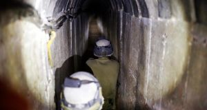 Israeli soldiers stand guard inside a tunnel exposed by the Israeli military near Kibbutz Ein Hashlosha, just outside the southern Gaza Strip, yesterday. Photograph: Amir Cohen/Reuters