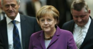 Chancellor Angela Merkel: seeking a coalition partner with whom to form a majority government coalition. Photograph: Gallup/Getty Images