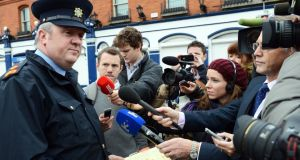 Supt David Taylor speaks to reporters at the scene of the  multiple shooting, in which four people were injured, at Hanlon's Corner in Dublin's north inner city yesterday. Photograph: Eric Luke