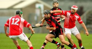 Harley Barnes of Ballygunner in action against Stephen Mason of Passage. Photograph: Ken Sutton/Inpho