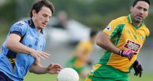 Sean Armstrong of Salthill Knocknacarra and Kieran Comer of Corofin. Photograph: Mike Shaughnessy/Inpho