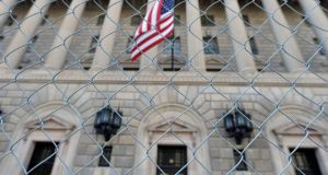 A fence surrounds the US Department of Commerce in Washington, as the government shutdown continues. US politicians remain at loggerheads despite the looming October 17th deadline. Photograph: Mike Theiler/Reuters