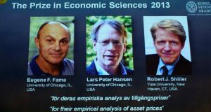 Photos of the 2013 Nobel Prize laureates in Economic Sciences Eugene Fama (L-R), Lars Peter Hansen and Robert Shiller are displayed during a news conference at the Royal Swedish Academy of Sciences in Stockholm today. The three American scientists won the 2013 economics Nobel prize  for research that has improved the forecasting of asset prices in the long term and helped the emergence of index funds in stock markets, the award-giving body said. Photograph: REUTERS/Claudio Bresciani/TT News Agency