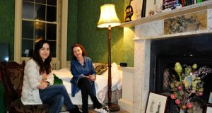 Marta Marin (left) and Monica Ennis, at the Georgian house in Dublin where they act as house-sitters. Photograph: Aidan Crawley
