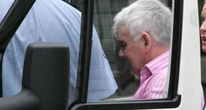 John Gilligan is taken by gardaí from the High Court  in 2010. Photograph: Cyril Byrne/The Irish Times