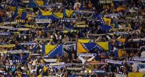 Bosnia fans cheer during their side's victory in the World Cup qualification match against Liechtenstein in Zenica last Friday. Photograph: Reuters