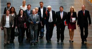 Members of Germany's Social Democratic Party (SPD) arrive for preliminary coalition talks with Germany's conservative (CDU/CSU) parties at the Parliamentary Society in Berlin today. Photograph: Reuters