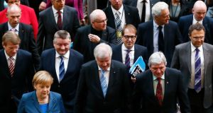 Members of Germany's conservative (CDU/CSU) parties arrive for preliminary coalition with the Social Democratic Party (SPD) at the Parliamentary Society in Berlin yesterday. Photograph: Tobias Schwarz/Reuters.