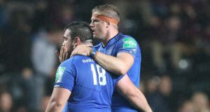 Leinster's Martin Moore is congratulated by Jamie Heaslip.