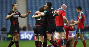Greig Laidlaw (9) of Edinburgh celebrates with Tim Visser (left), Wicus Blaauw and Jack Cuthbert after that surprising defeat of Munster at Murrayfield on Saturday. Photograph: Ian MacNicol/Getty Images