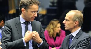 Dutch Finance Minister and Eurogroup President Jeroen Dijsselbloem (L) and Luxembourgish Finance Minister Luc Frieden (R) prior to a Eurozone finance ministers meeting.