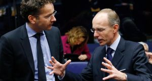Euro group chairman Jeroen Dijsselbloem listens to Luxembourg's Finance Minister Luc Frieden during an euro zone finance ministers meeting in Luxembourg yesterday. Photograph: Francois Lenoir/Reuters.
