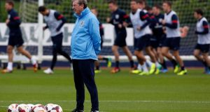 England's manager Roy Hodgson watches a training session ahead of their World Cup qualifyier against Poland.