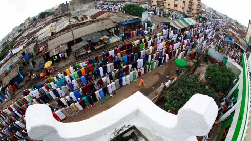 Muslims pray during Eid el-Kebir at a mosque in Koumassi, in the Ivorian capital, Abidjan. Muslims around the world celebrate Eid el-Kebir, also known as Eid al-Adha, by slaughtering sheep, goats, camels and cows to commemorate Prophet Abraham's willingness to sacrifice his son, Ismail, on God's command. Photograph: Thierry Gouegnon/Reuters