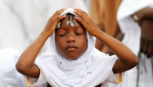 A girl prays during Eid el-Kebir at a mosque in Koumassi, in the Ivorian capital Abidjan. Photograph: Thierry Gouegnon/Reuters