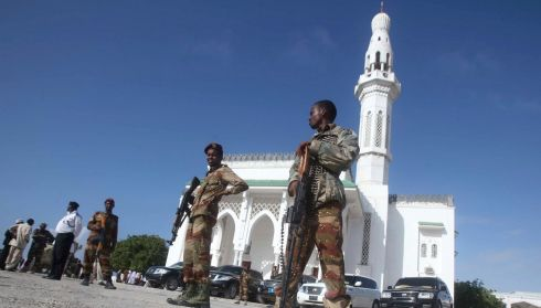 Somalian soldiers stand guard outside the Isbahaysiga Mosque during prayers on the first day of Eid al-Adha in Mogadishu.  Photograph: Ismail Taxta/Reuters