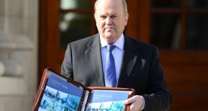 Minister for Finance  Michael Noonan who today published a budget containing 25 pro-business and pro-jobs measures worth half a billion euro.  Photograph: Bryan O'Brien / THE IRISH TIMES