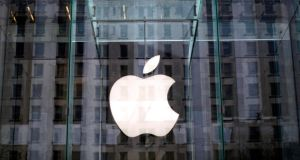 The Apple logo hangs inside the glass entrance to the Apple Store on 5th Avenue in New York City. Photograph: Mike Segar/Reuters