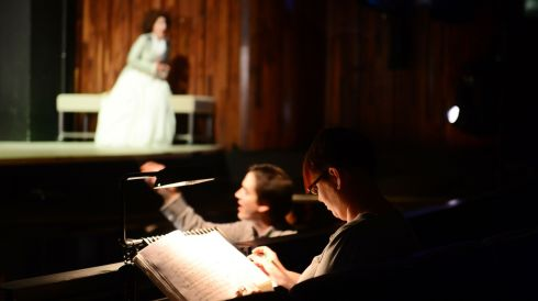 Nora Sourouzian in dress rehearsals for Therese which opens in the Wexford Opera Festival next week . Foreground are Ellie Bowers-Jolly (Chorus manager) and orchestra conductor Carlos Izcaray (right). Photo: Bryan O' Brien / The Irish Times