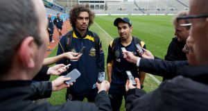 Tony Armstrong and Eddie Betts of the AFL Australian International Rules team speak with the media after a training session at Croke Park. Photograph: Patrick Bolger/Getty Images