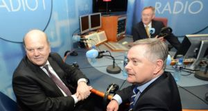 Minister for Finance Michael Noonan and the Minister for Public Expenditure and Reform Brendan Howlin with presenter Sean O'Rourke in the RTE Radio studio to answer listeners questions. Photograph: Eric Luke/The Irish Times