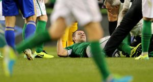 Republic of Ireland midfielder Darron Gibson is treated after he injured a knee in the World Cup qualifier against Kazakhstan at the Aviva Stadium. Photograph:  Cathal Noonan/Inpho