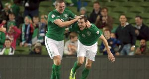 Richard Dunne congratulates his fellow centre half after he scored the Republic of Ireland's second goal in the World Cup qualifier against  Kazakhstan at the Aviva Stadium. Photograph: Morgan Treacy/Inpho