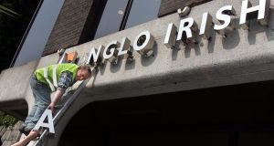 Anglo Irish Bank signage being removed from the former bank premises at St Stephen's Green Dublin in April 2011. Photograph: Matt Kavanagh/The Irish Times