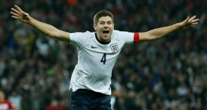 England captain Steven Gerrard celebrates his late goal during the World Cup qualifying game against Poland at Wembley.