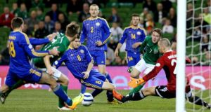 The Republic of Ireland's Aiden McGeady (second right) crosses the ball which resulted in Kazakhstan's Dmitriy Shomko (left) scoring an own goal during Tuesday's World Cup qualifier at the Aviva Stadium. Photograph; Brian Lawless/PA Wire