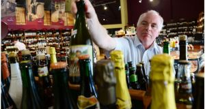 Finian Sweeney in Sweeney's off-licence in Phibsborough, Dublin. Photograph: Bryan O'Brien