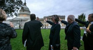 Religious leaders pray outside the Capitol on Wednesday, the 16th day of the government shutdown in Washington. Photograph: Doug Mills/The New York Times