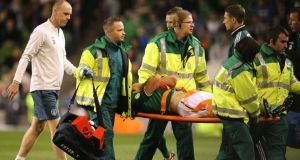 Darren Gibson is taken off on a stretcher after sustaining a knee injury at the Aviva stadium. Photograph: Cathal Noonan/Inpho