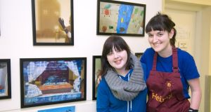 Patient Kayleigh Fox beside her artwork with artist Emma Fisher at University Hospital Galway.