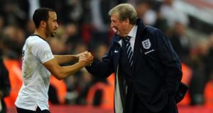 England manager Roy Hodgson shakes hands with Andros Townsend during the midweek victory over Poland. Photograph: Mike Hewitt/Getty Images
