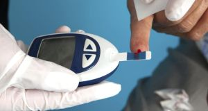 Blood sugar reading: Checking blood sugars: people with diabetes lack the insulin required to break down sugars to allow them to power muscles and other cells in the body. This lack of insulin means that people with diabetes have a build-up of sugar in the blood or high blood sugar levels. Photograph: Getty Images