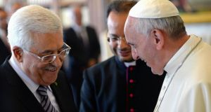 Pope Francis talks to Palestinian president Mahmoud Abbas (left) during a private audience in the pontiff library at the Vatican. Photograph: Maurizio Brambatti/Pool/Reuters