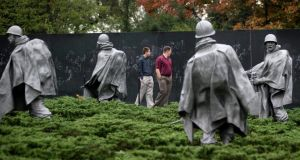 Visitors walk through the Korean War Veterans Memorial in Washington, DC, after the facility reopened. Photograph: Andrew Harrer/Bloomberg