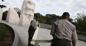 US Park Service workers remove a barricade that was used to close the Martin Luther King Memorial  after a bipartisan Bill was passed by the House and the Senate to reopen the government and raise the debt limit. Photograph: Mark Wilson/Getty Images