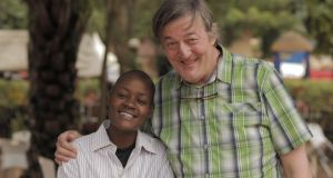 Out there, right now: Stephen Fry in Uganda with Stosh, who is gay, and who was 'correctively' raped at the age of 14