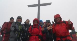 The group at the top of Carrauntoohil with mountaineer Eamonn Falvey (right).